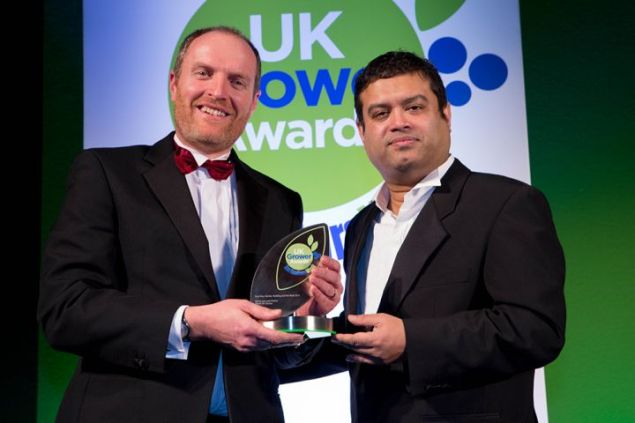 Plants for Europe's Graham Spencer collecting the Best New Variety award from compère Paul Sinha