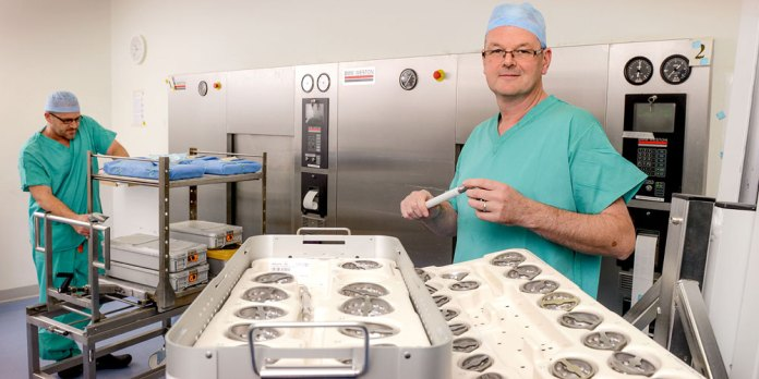 An operating theatre at The Horder Centre with Theatre Manager Joe Christmas