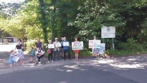 Parents and children demonstrating about cuts to respite care outside Grove Park Special School in Crowborough
