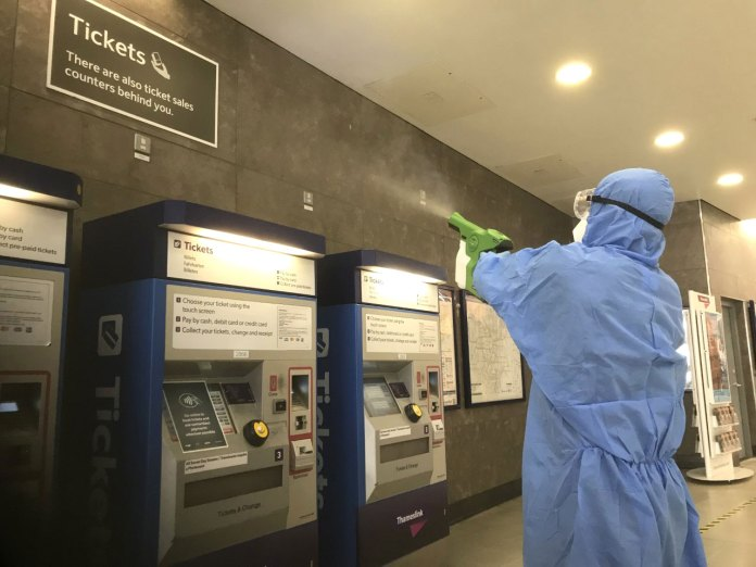 Electrostatic spray gun being used to apply viruscide at Blackfriars station.