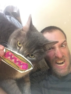 Blogger and his cat Playing with a mask