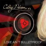 5DD571 – Cathy Dobson – Love Ain't Bulletproof - Cover