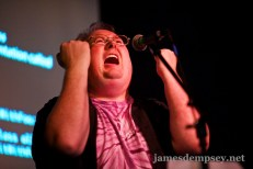 James sings, looking skyward, both hands clenched in fists