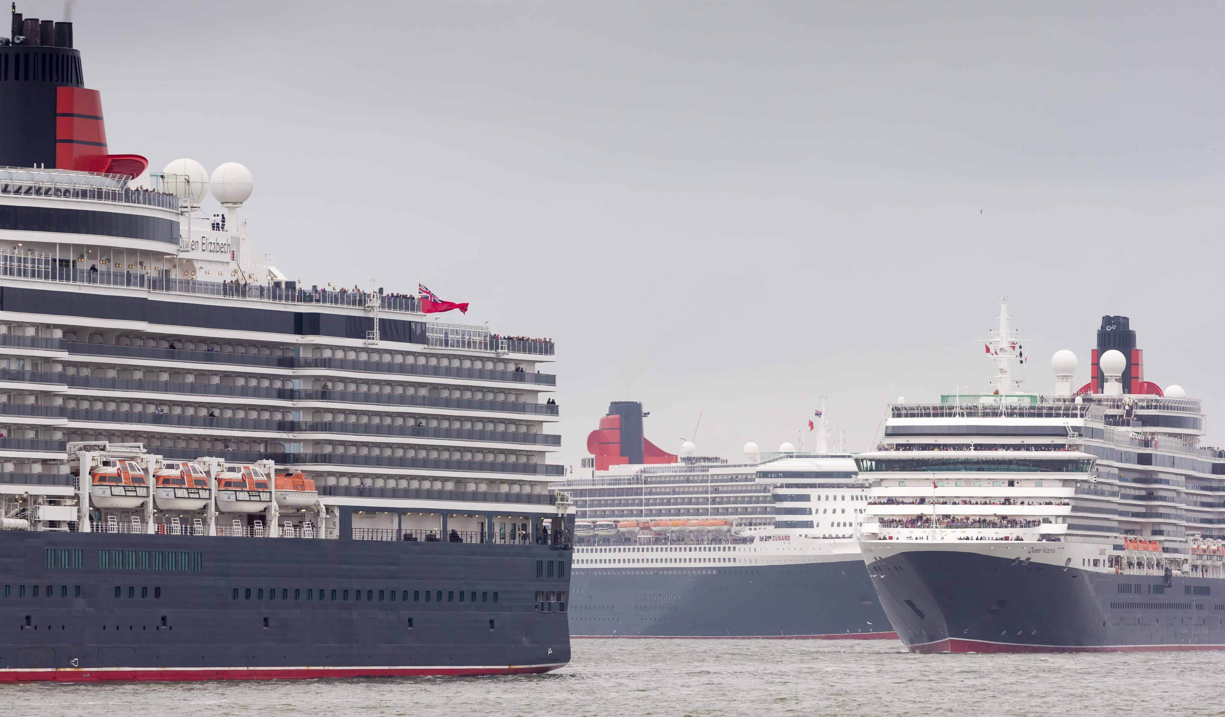Cunard's fleet gather together in spectacular fashion in Liverpool, its spiritual home, as the company marked its 175th anniversary. Left to right: Queen Elizabeth, Queen Mary 2 and Queen Victoria. The historic lines' three ships, the largest passenger ships ever to muster together on the River Mersey, lined up just 130 metres apart. The vessels lined up three abreast at Liverpool's Pier Head beside its iconic Three Graces: The Royal Liver Building, The Cunard Building and The Port of Liverpool Building. Picture date Monday 25th May, 2015. Picture by Christopher Ison.