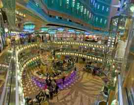 Guests on the Carnival Magic relax in the Magic Atrium. The 130,000 ton Carnival Magic can accommodate 3,690 guests. Photo by Andy Newman/Carnival Cruise Lines