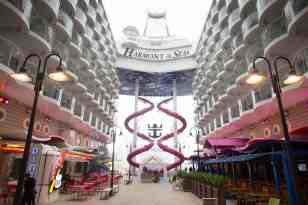 Royal Caribbean International's Harmony of the Seas, the world's largest and newest cruise ship, previews in Southampton, UK. Boardwalk showing The Ultimate Abyss slide.