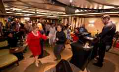 Guests dance in Havana Bar aboard the Carnival Vista. The largest and most innovative cruise vessel in Carnival Cruise Line's fleet, Carnival Vista measures 133,500 tons, 1,055 feet long and has a guest capacity of almost 4,000 passengers. Photo by Andy Newman/Carnival Cruise Line