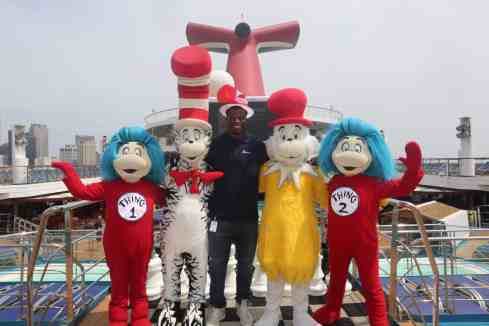 "New Orleans Saints tight end Benjamin Watson reads a Dr. Seuss Book to a group of children during the ""Dr. Seuss at Sea"" on the Carnival Triumph cruise liner at the Port of New Orleans on Saturday, July 21, 2018. (Photo by Peter G. Forest)"