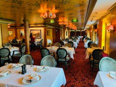 the grand and elegant french specialty restaurant le bistro aboard norwegian jade
