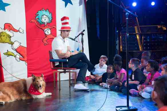 """Tampa Bay Rays all-star Evan Longoria reads the new Dr. Suess book """"What Pet Should I Get?"""" to children aboard Carnival Paradise"""