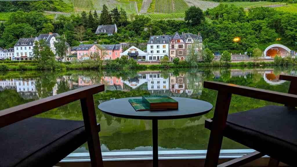 A balcony cabin view aboard Emerald Destiny