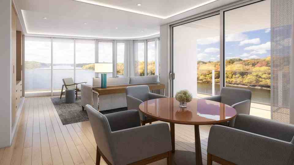 Rendering of the Viking Mississippi - Forward Explorer's Suite Living Room on Deck 3.