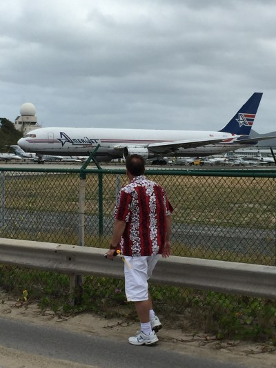An aeroplane getting ready to take off at Maho Beach.
