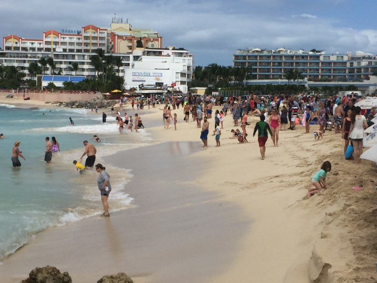 Maho Beach can get crowded with tourists eagerly awaiting aeroplanes to arrive and take off.