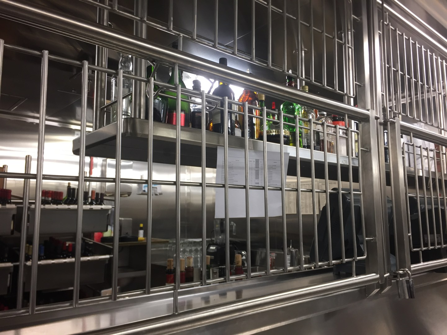 When you order a drink in the main dining room, the waiting staff can get it from a caged section of the galley.