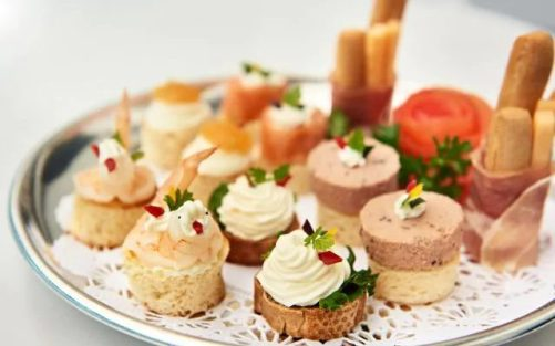Complimentary canapes in your Club Class mini-suite