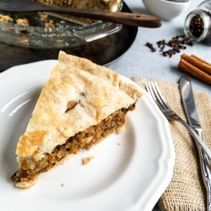 Vegan Tourtiere Pie sliced on a white plate