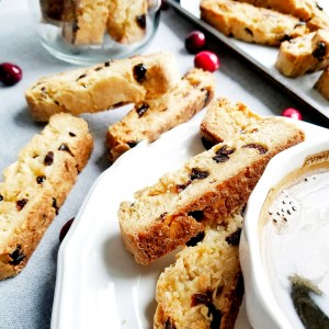 vegan cranberry almond biscotti served with a cup of espresso