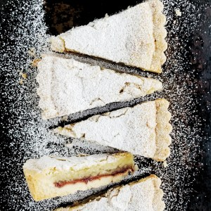 Vegan Bakewell Tart sliced, showing the inside layers
