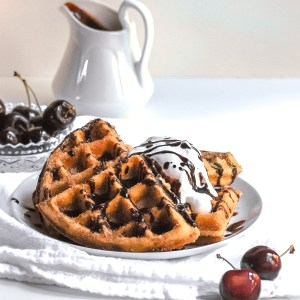 Vegan Churro Waffles served with coconut whip and chocolate sauce
