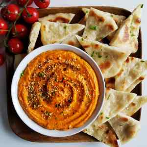 Romesco served with pita bread and cherry tomatoes