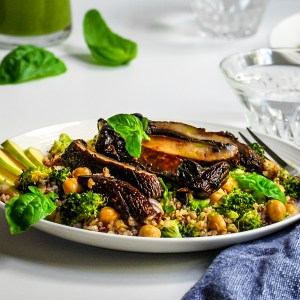 Portobello, Broccoli, Chickpea and Grain Salad with Fresh Lemon Basil Dressing served on a white plate