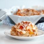 Vegan Peach Cinnamon Roll with Almond Oat Streusel and Almond Glaze on a plate