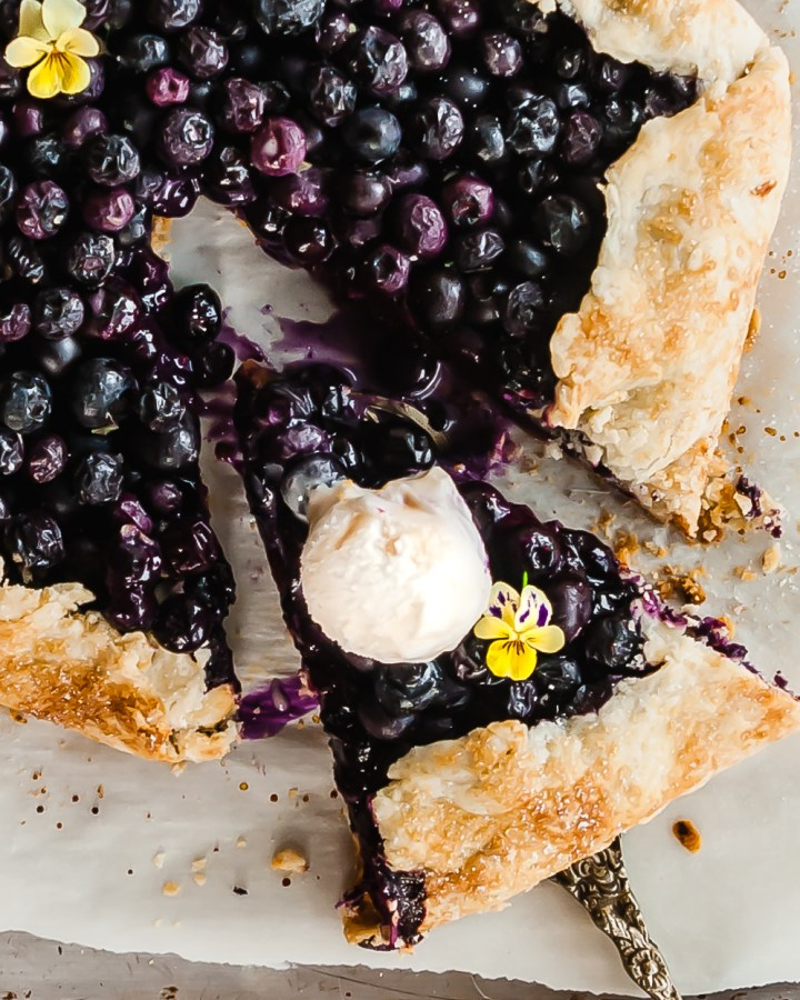 Vegan Blueberry Ginger Galette sliced and served with vegan ice cream