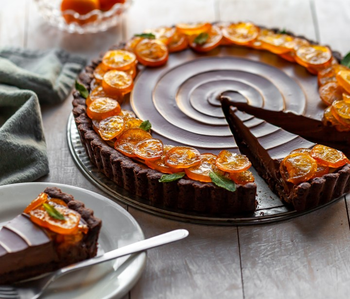 Vegan Chocolate Orange Truffle Tart with Candied Kumquats sliced and served