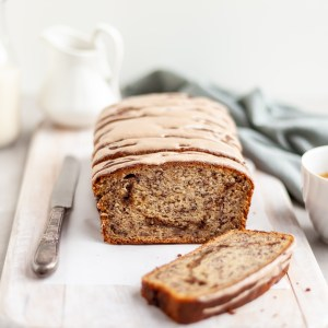Vegan Cinnamon Swirl Banana Bread glazed and sliced