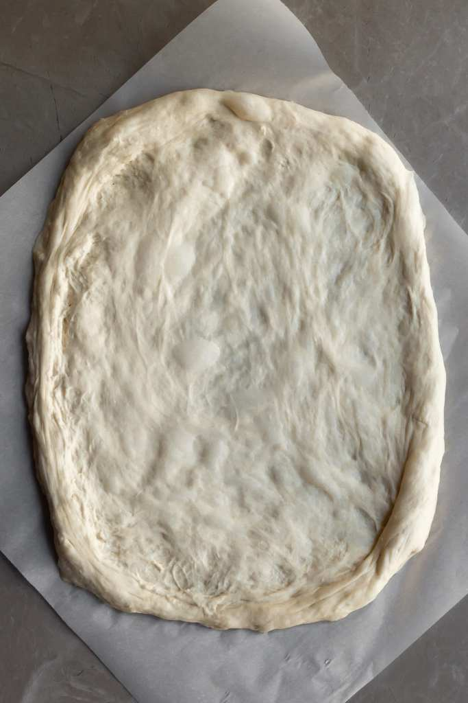 Pizza dough stretched out ready for sauce ad toppings