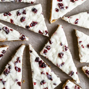 Flatlay of cranberry bliss bars cut into triangles