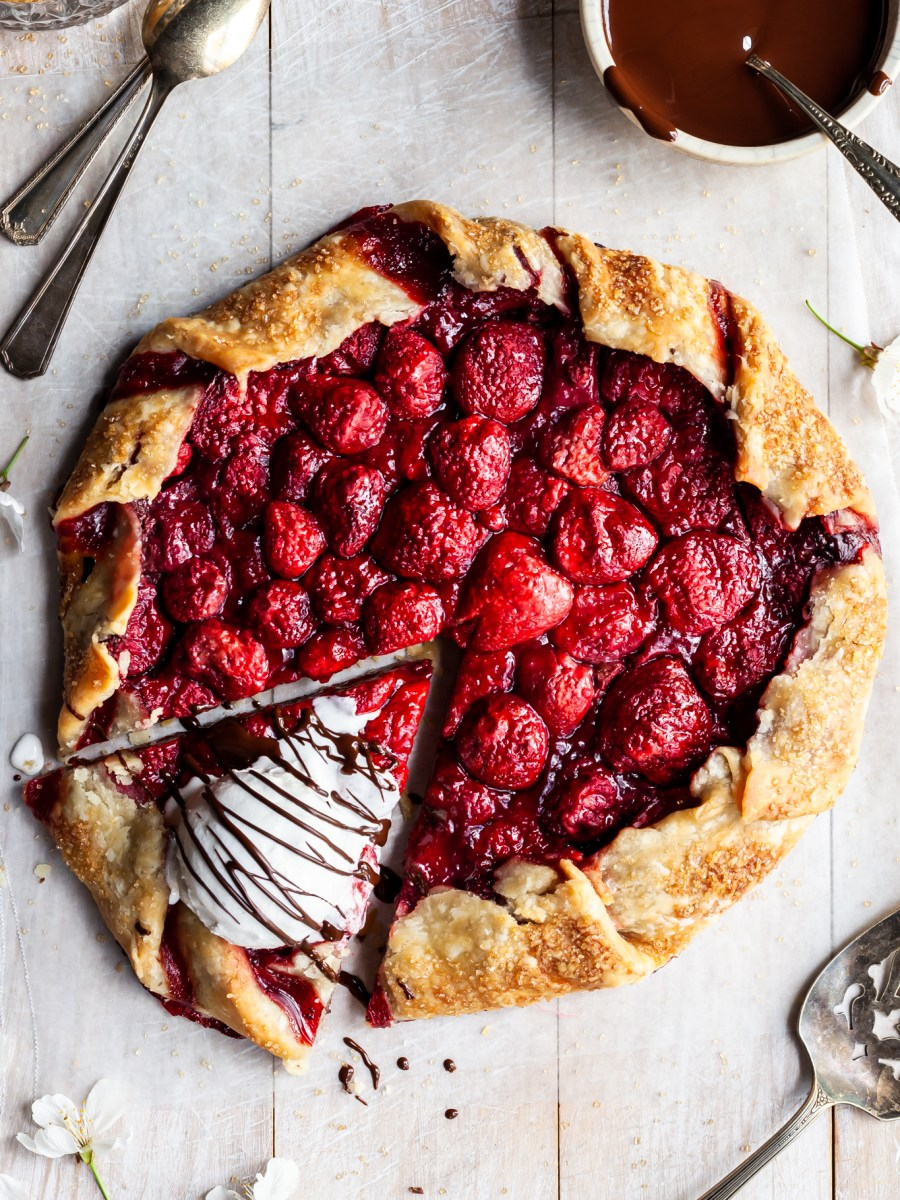 Strawberry galette with ice cream on the one slice which has been cut
