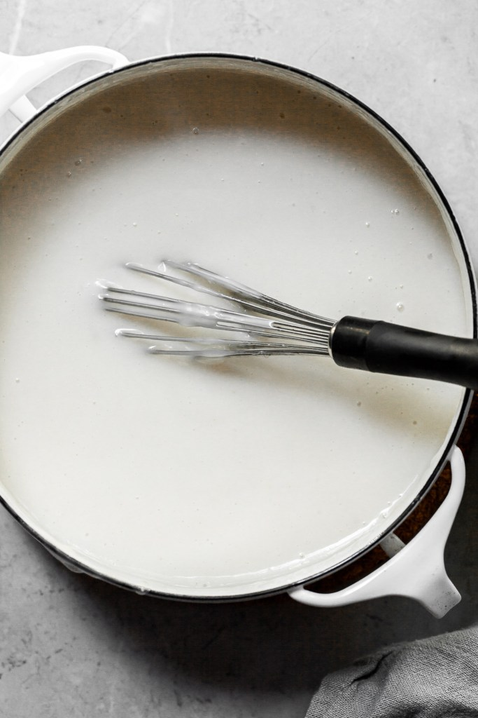 A white pot filled with a creamy white custard