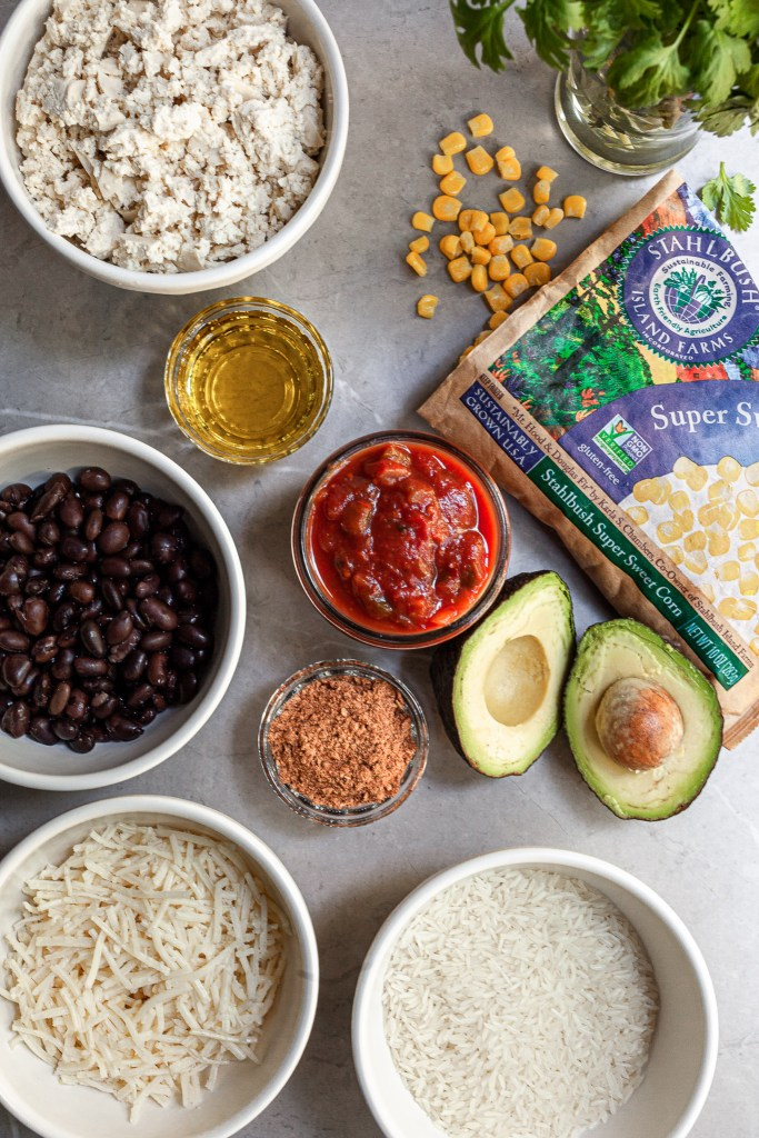 Ingredients for Mexican rice skillet laid out on a marble counter-top