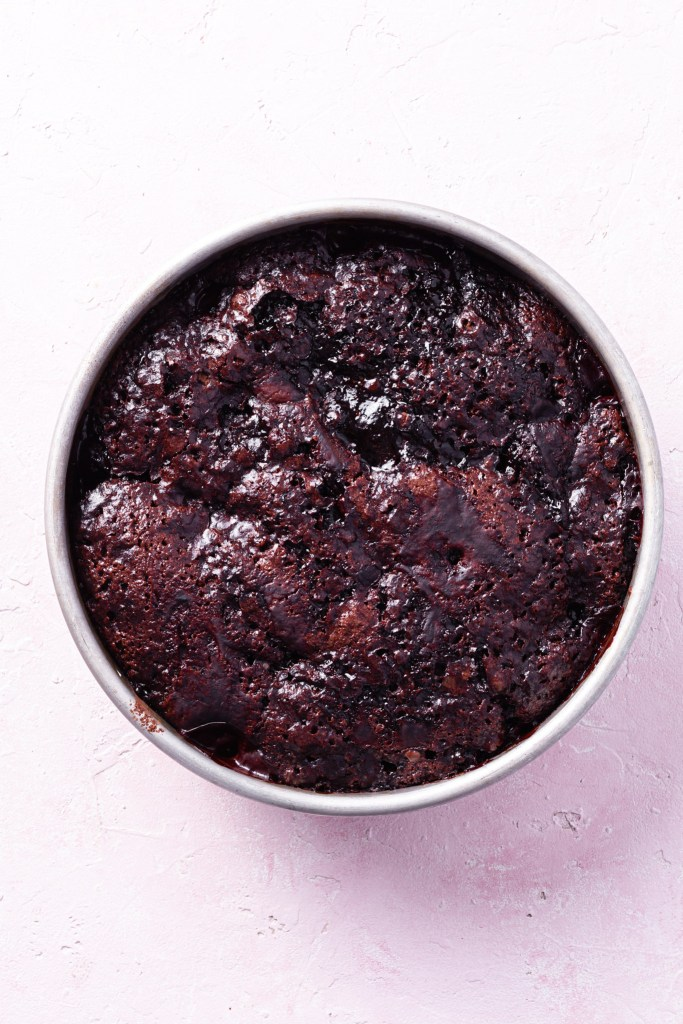 A baking dish filled with the freshly baked self-saucing chocolate strawberry pudding.