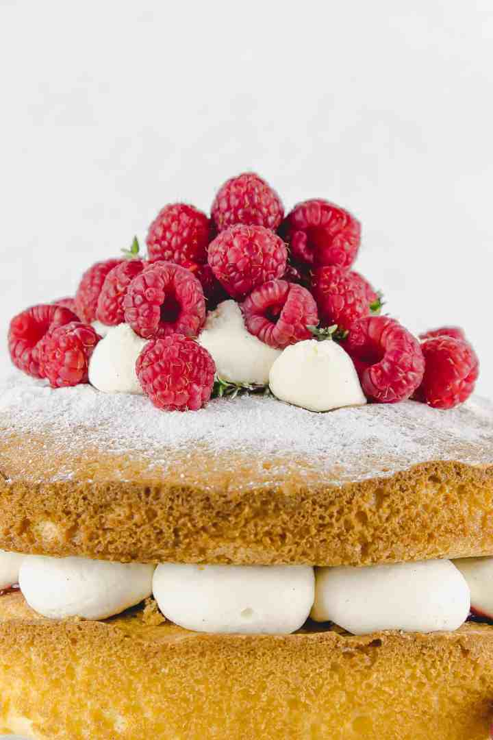 Close up of fresh raspberries on top of classic sandwich sponge cake
