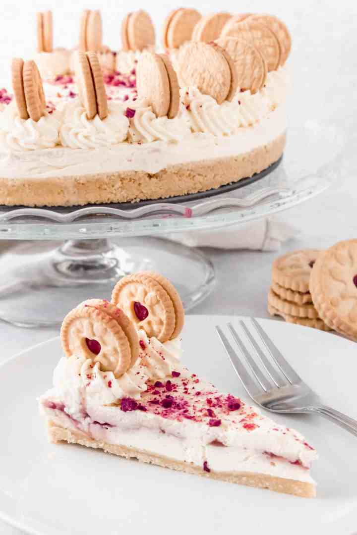 Slice of Jammie Dodger cheesecake on a white plate