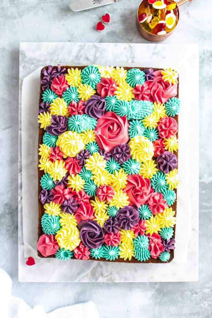 Vanilla tray bake cake on a marble slab