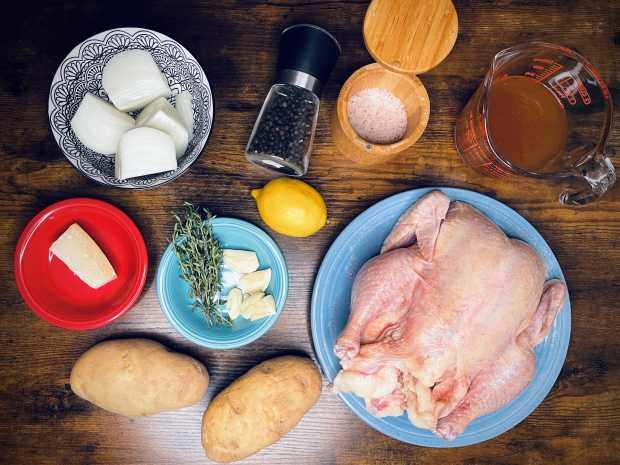 whole chicken, potatoes, onion, garlic, lemon, thyme, salt, pepper, chicken stock, parmesan cheese