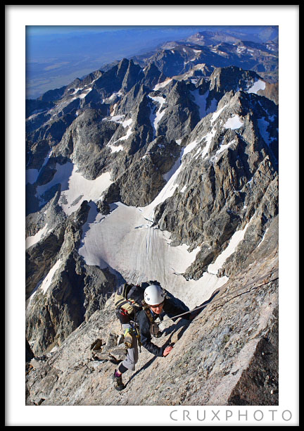 Kelly Perkins smears onto the Unsoeld's layback pitch on the Exum Ridge.  Copyright Nate Young and Crux Photo.