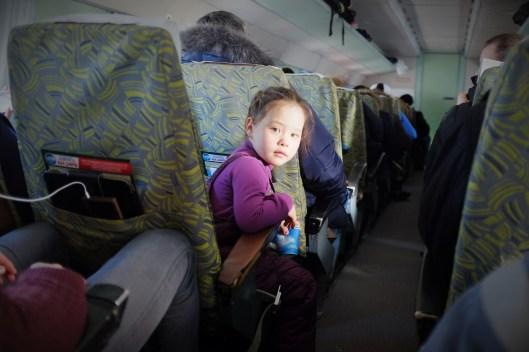 A girl on a Soviet-era plane between Mirny City and Yakutsk, Russia.
