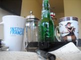 Our writing utensils. Note the mug I won from the French Embassy for writing (very poorly) my first poem in French.
