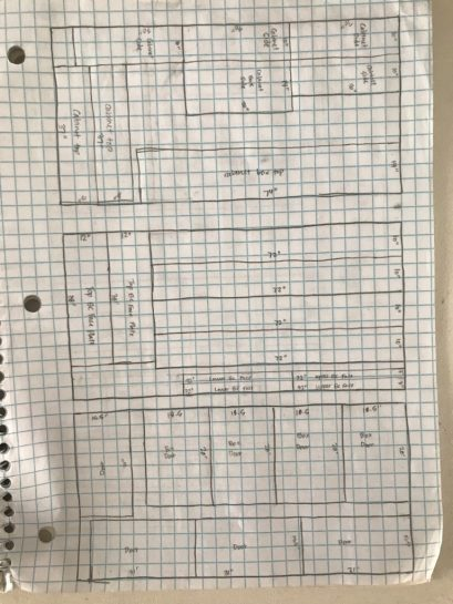 Photo of piece of graph paper with measurements and drawings of where to cut the MDF