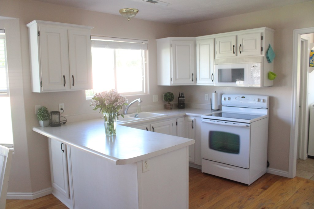 Kitchen with painted white cabinets before granite and before floor was refinished