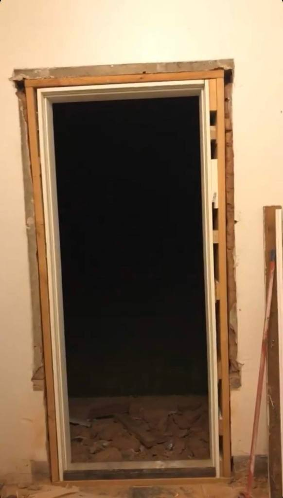 Partially framed doorway before door was installed and before gap filler was used