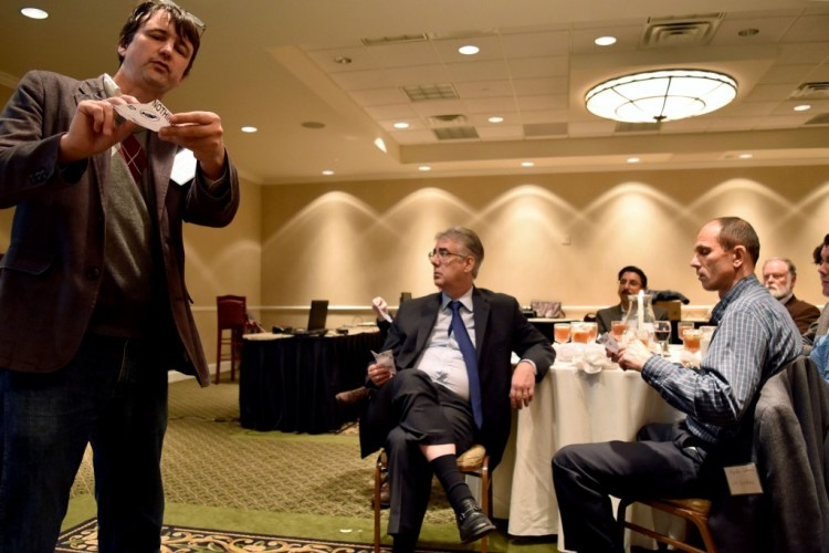 Dr. Jack S. Snoeyink using origami with attendees to explain points in his talk.