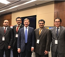 From left to right: Suraj Raghuraman, PhD Student; Dr. Balakrishnan Prabhakaran; Congressman Lamar Smith (TX); Project collaborator and community partner from Dallas Veterans Affairs, Dr Thiru Annswamy; Yuan Tian, PhD Student.