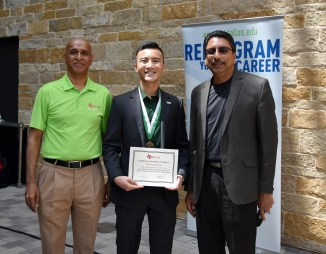 Brian Hoang accepting the Certificate of Academic Excellence