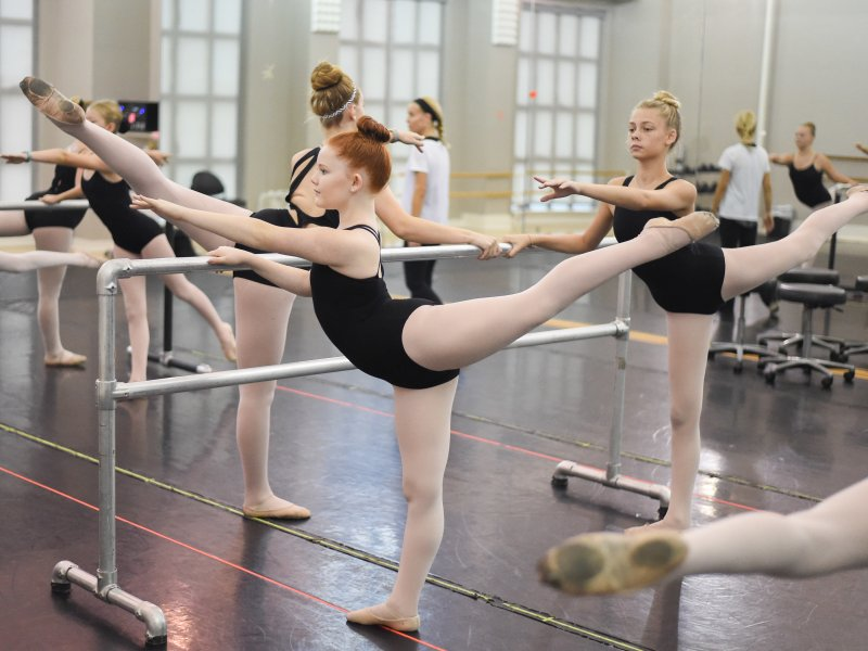Girls in ballet class at CSBI doing arabesque